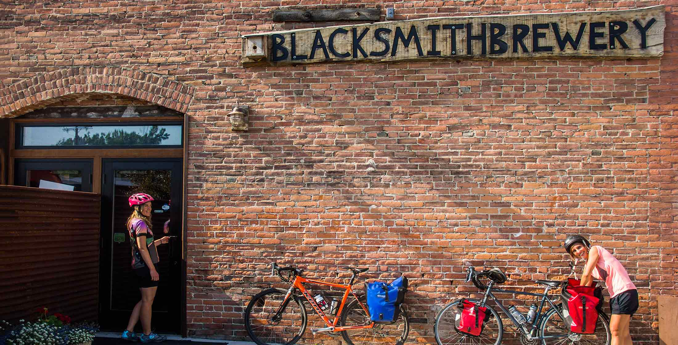 Bikers stop at Blacksmith Brewery on the Bitterroot Trail