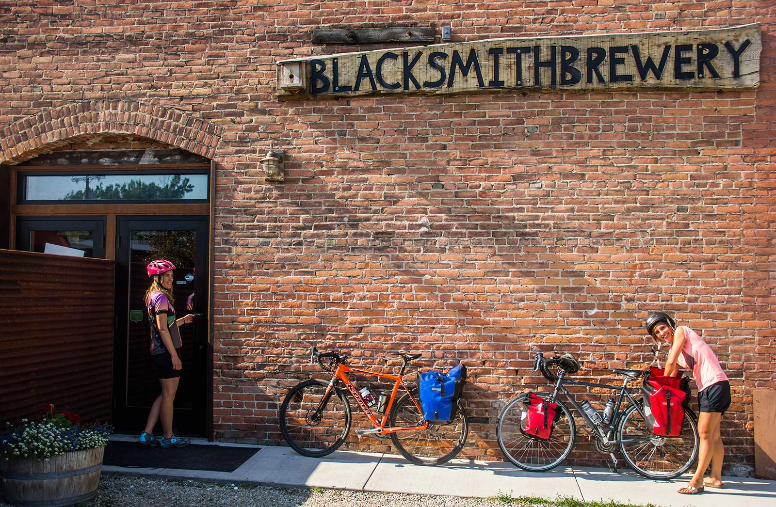Cyclists stop for a beer at Blacksmith Brewery on the Bitterroot Trail in Stevensville