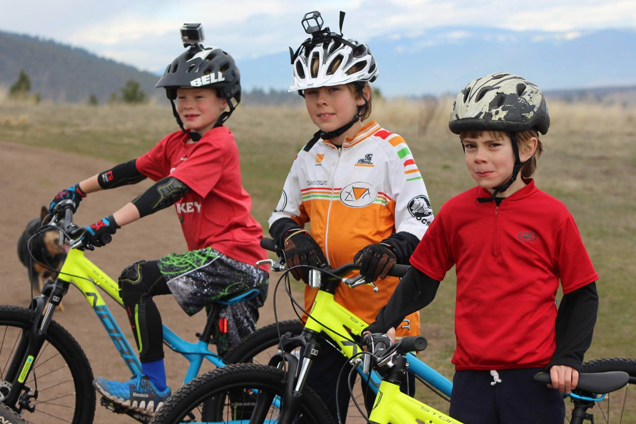 Young cyclists pose for a photo on the Bitterroot Trail